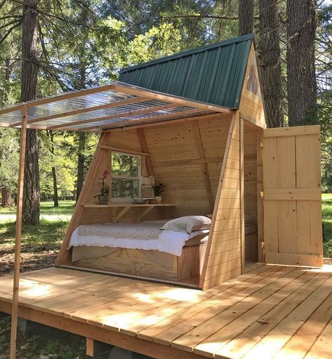 small cabin furnished with bed frame simple floating table transparent shade with wood frames and trims