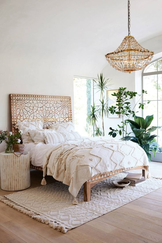 stunning bed frame with Moroccan motifs carved along the footboard headboard and rails accent chandelier