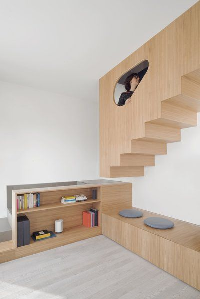 unique staircase made of light wood clean line wooden bench with round gray cushions