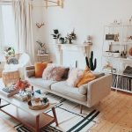 Boho Minimalist Living Room With Midcentury Modern Style Sofa Light Pink And Earthy Color Throw Pillows Wood Coffee Table Black White Area Rug With Tassels Light Wood Floors