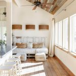 Bright Open Space With White Stools White Daybed White Foot Rest Light Wood Plank Floors White Draperies Glass Windows