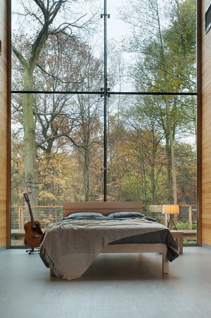 contemporary bedroom design with glass wall accent simple wooden bed frame with headboard