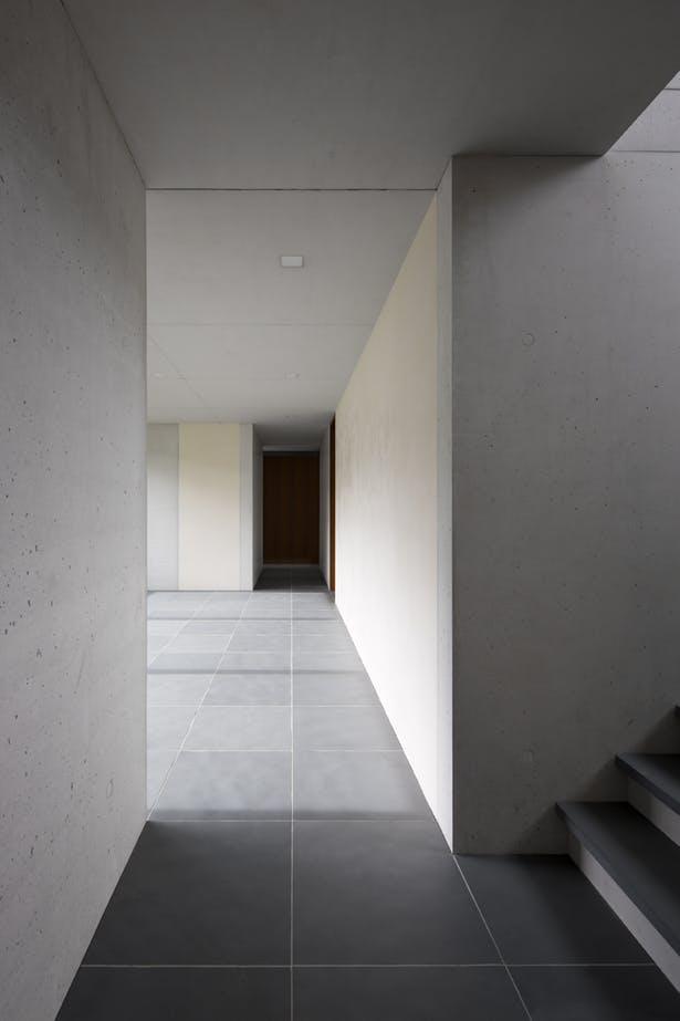 corridor displaying modern minimalist interior dominated by whites