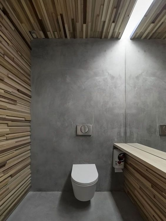 modern bathroom idea with concrete walls and wood cladding highlight wall mounted toilet in white