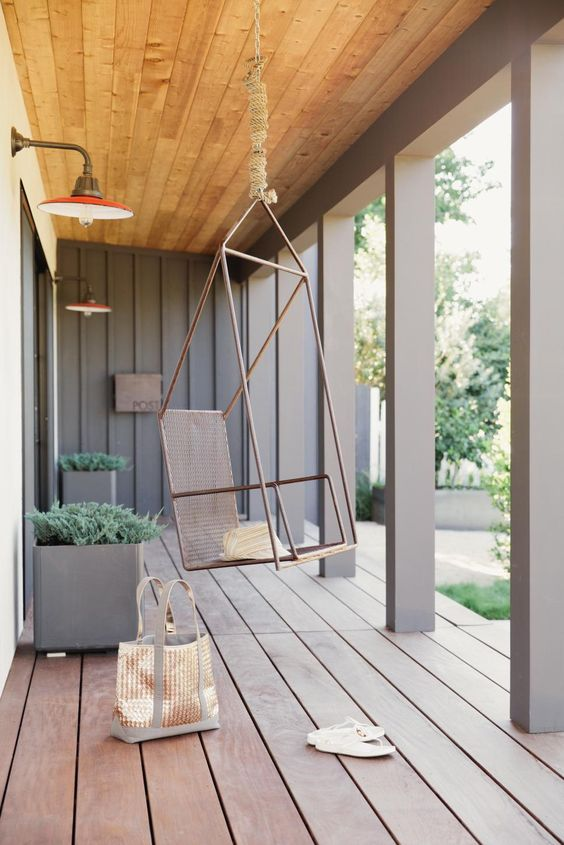 modern terrace idea with wood plank floors big planters modern hanging chair
