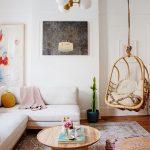 Modern White Sectional Sofa Rounnd Top Wood Coffee Table Soft Boho Style Area Rug Boho Style Floor Cushion Rattan Hanging Chair With Cushion