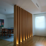 Natural Wood Partition With Lighting Effect At Base