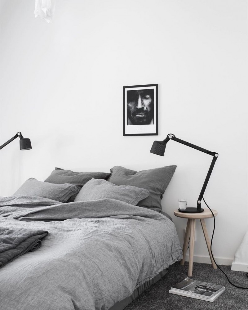 simple elegant bedroom with gray bedding treatment ultra light wood stools black table lamps in modern style gray rug white walls