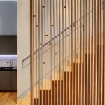 Small Apartment With Natural Wood Railings Space Divider