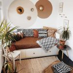 Small Sitting Area With Daybed With Drawers Underneath Small Chair In White Round Top Side Table Some Greenery