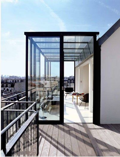 ultra modern screened terrace with black framed glass screen and black metal railings