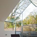 Ultra Modern Terrace With Fabulous Chair And Frameless Glass Roof