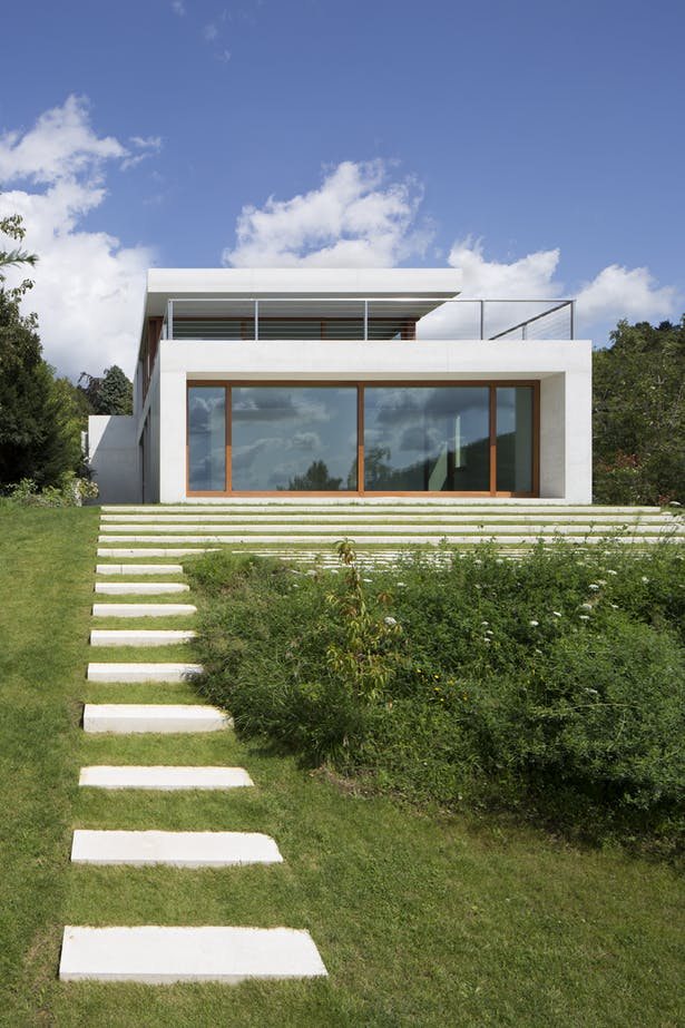 villa in uphill with amazing exterior staircase glass windows and door with wood frame