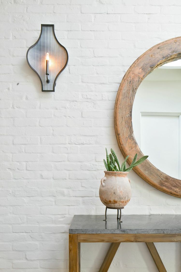 white brick wall idea round wall mirror with wood frame hallway console table with gray top