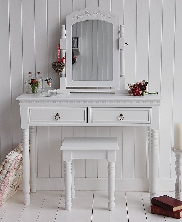 white makeup table with a couple of drawers and built in mirror white stool