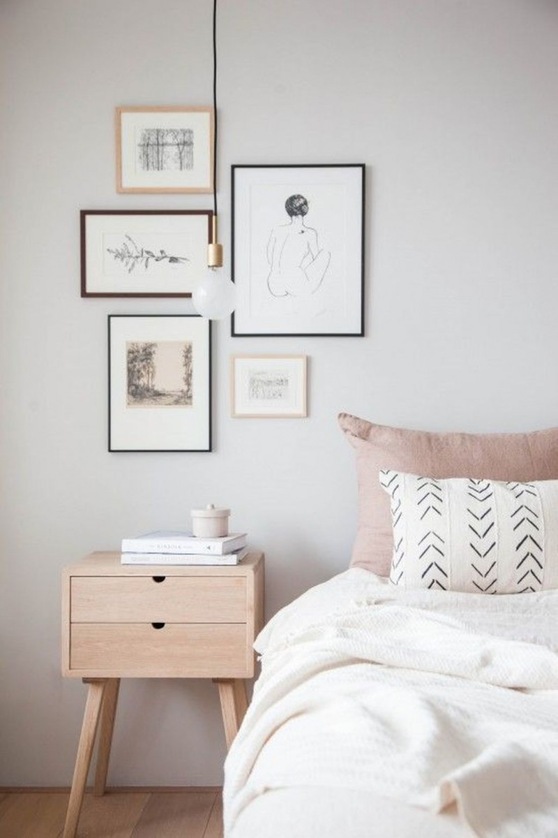 white walls with framed picture decorations ultra light wood bedside table white bedding linen ulyra soft pillow
