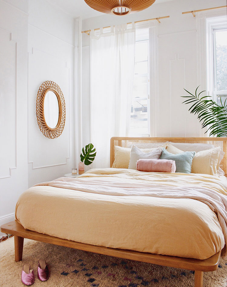 wood frame with headboard peach bedding linen round shaped wall mirror with beautiful frame