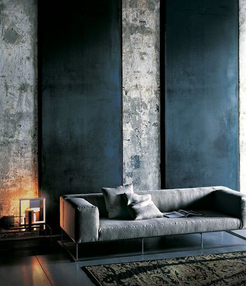 concrete walls featuring matte black walls concrete colored sofa with throw pillows