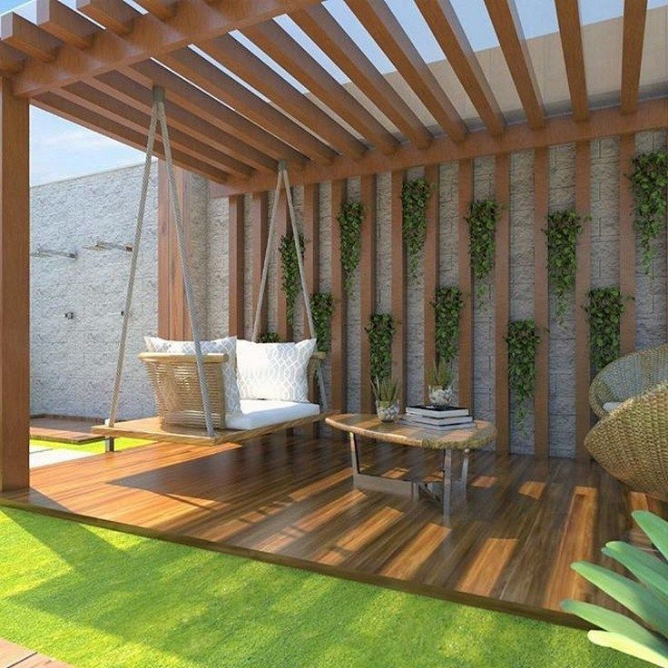 cool patio in the backyard with modern swing chair plus cushion modern wood ceilings and walls with green vines ornament
