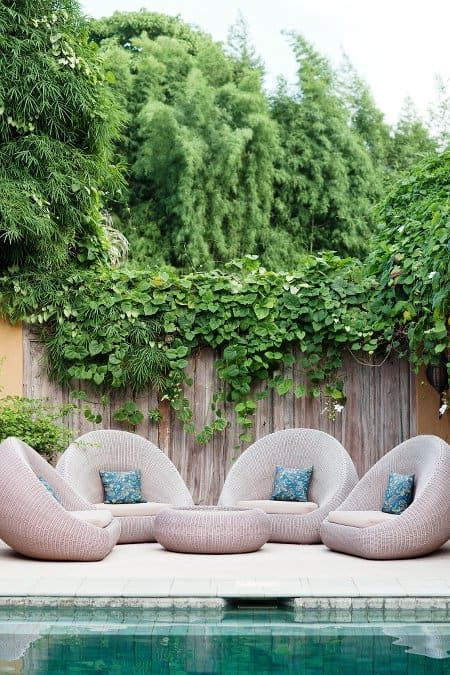 eathy soft outdoor furniture set with blue accent pillows