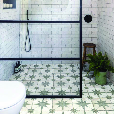 green olive star patterned tile floors white subway tile walls clear glass walk in shower divider with black metal frames and trims