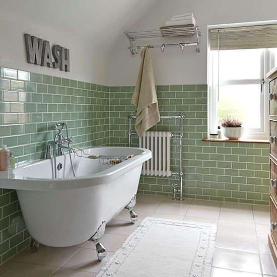industrial bathroom design with green subway tile walls white runner claw foot bathtub in white