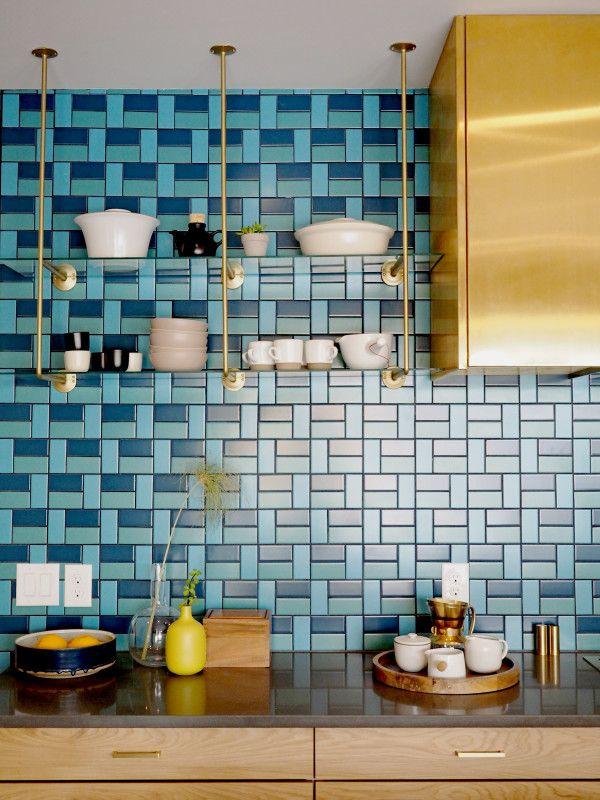 light and deep blue tile backsplash idea brass kitchen cabinets brass open shelving unit