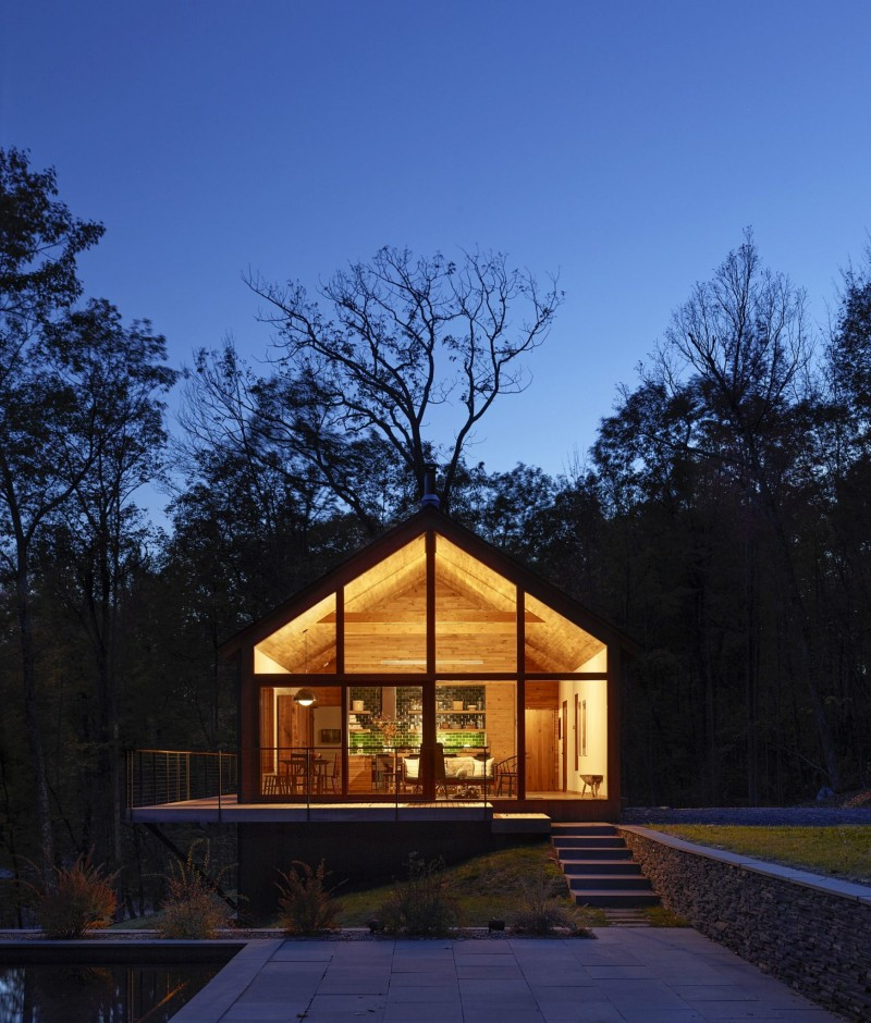 midcentury modern cabin design after sunset