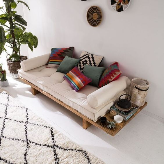 midecentury modern daybed with white tufted cushion and Boho style accent pillows