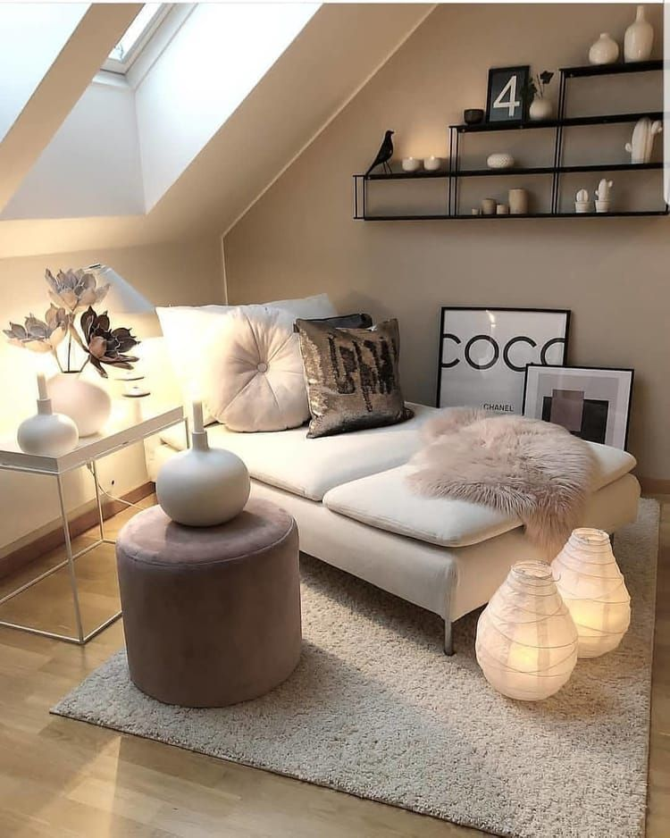 minimalist chaise with throw pillows and throw blanket white rug ultra soft pink stool as side table a couple of lanterns like light fixtures