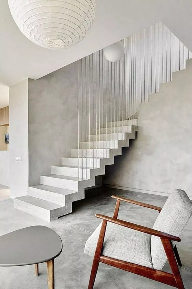minimalist interior with minimalist staircase with railings minimalist furniture set