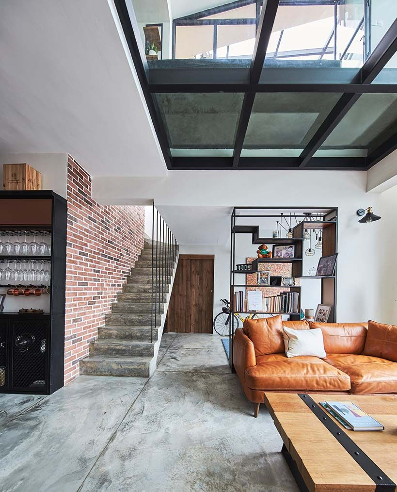 modern loft design with industrial style elements leather sofa wood coffee table modern industrial bookshelves