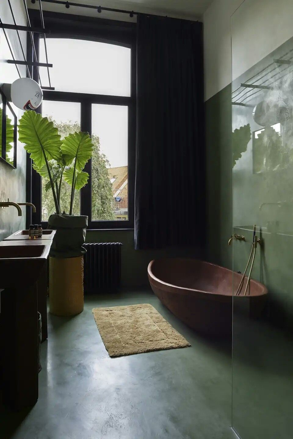 sage bathroom walls dark green concrete floors dark brown bathtub soft bathroom mat