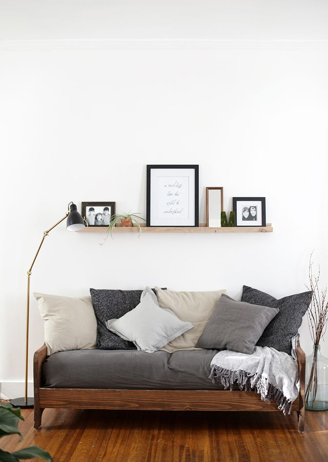 small living room idea with hardwood furniture plus cushions and throw pillows in gray and white modern floor lamp
