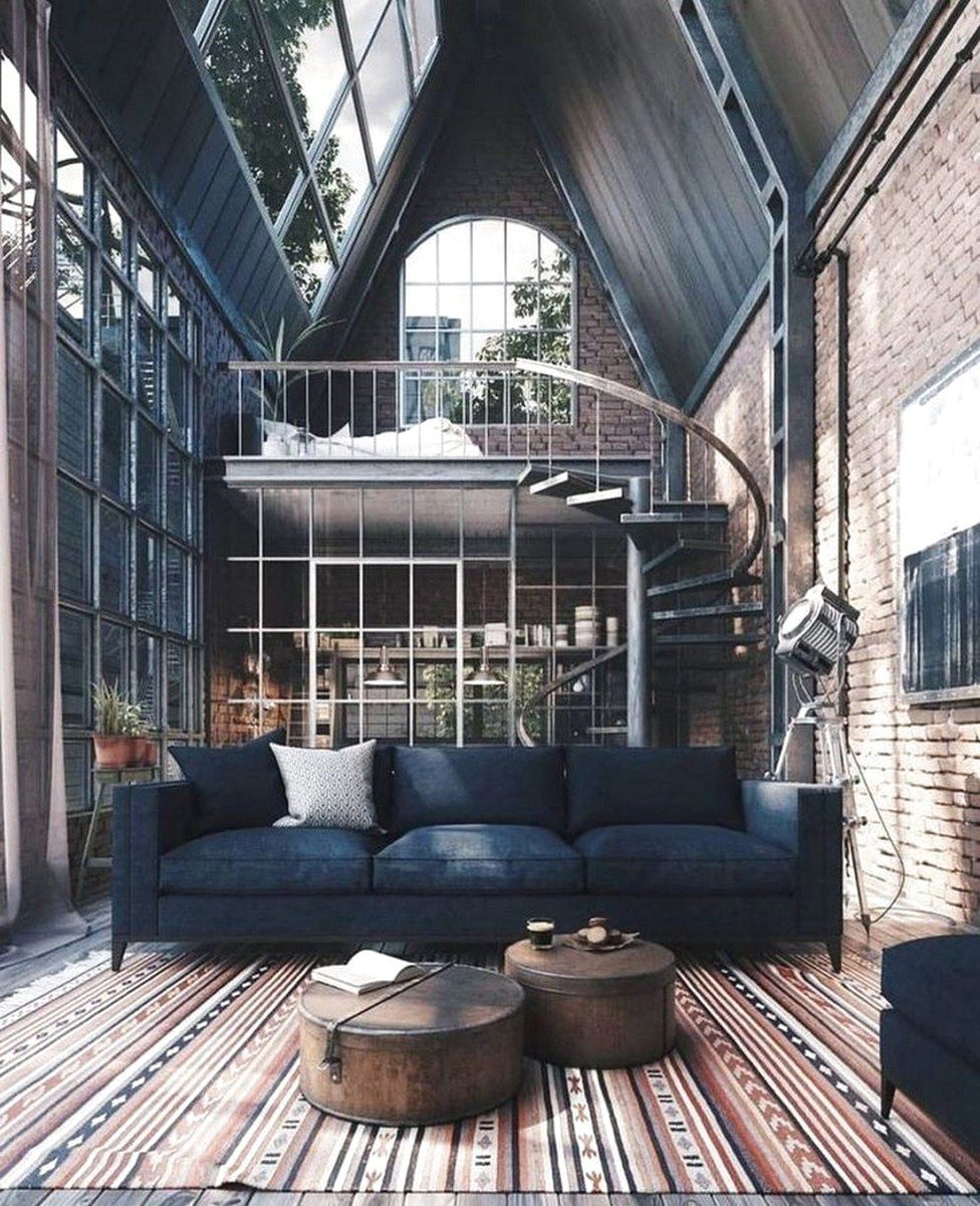 tiny loft design in industrial style black sofa rustic coffee tables ethnical area rug twister metal staircase industrial glass windows with black trims