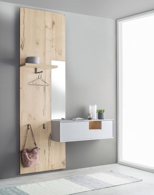 ultra minimalist dressing room with wall mounted dressing table frameless mirror wood accent wall as the bag storage solution
