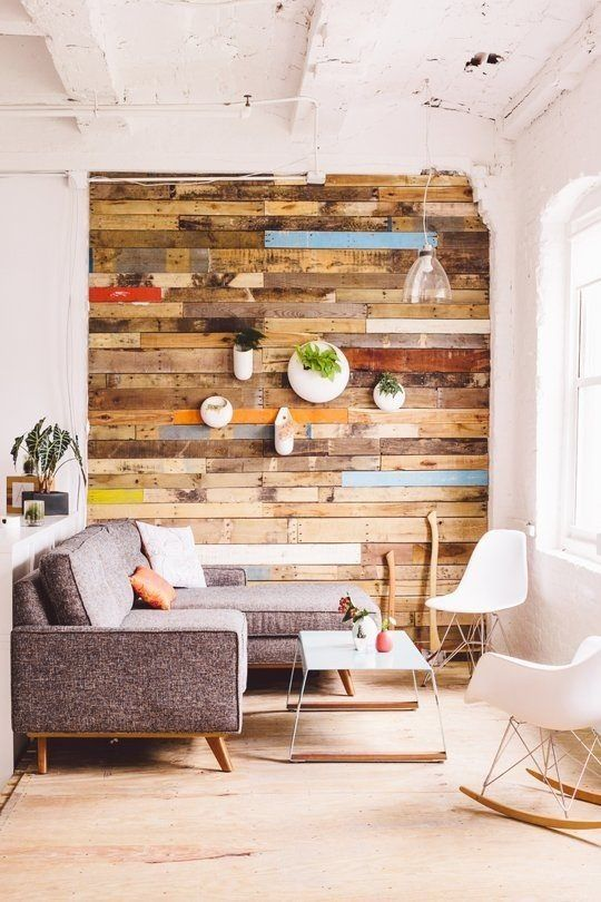 Scandinavian style living room design with gray sofa tiny coffee table Scandinavian style rocking chair in white Scandinavian style chair in white wood reclaimed wallpapers