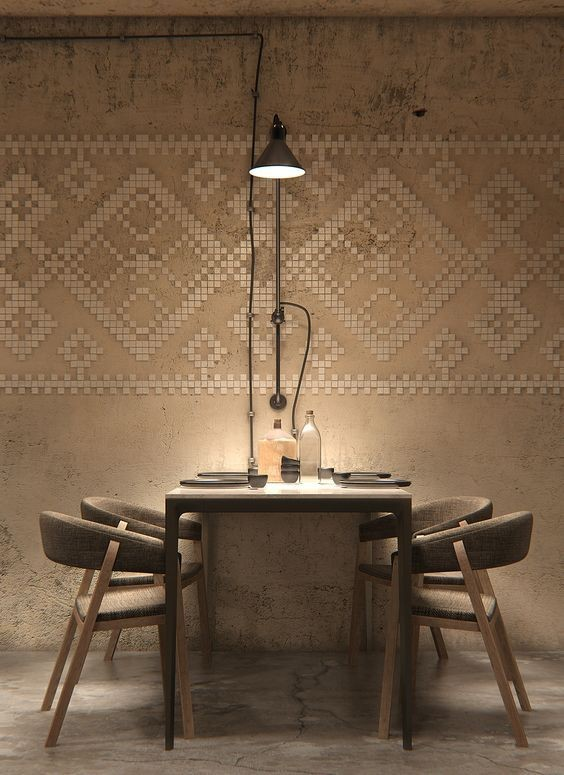 Wabi sabi dining space with modern dining furniture industrial style light fixture geometric patterned walls