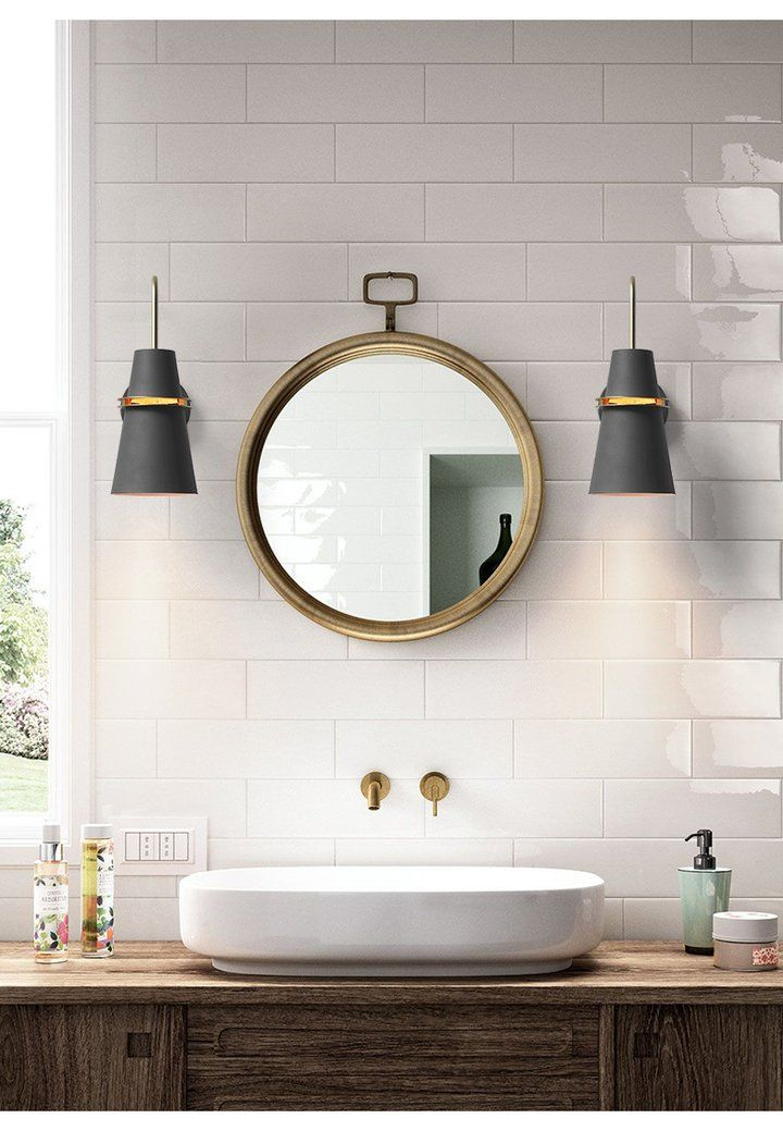 bathroom vanity lamps in black round mirror with gold frame white sink subway tile backsplash in white