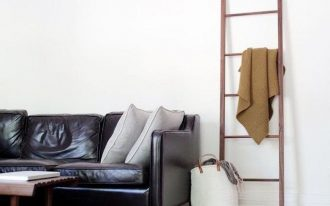 black leather sofa with gray throw pillows ladder rack
