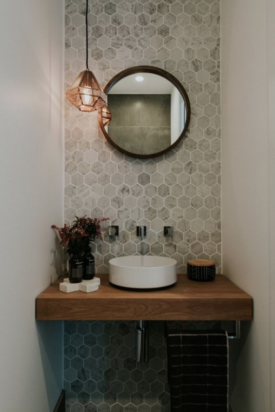 cool industrial bathroom inspiration with warm gray hexagon tile walls round wall mirror with black frame single white sink