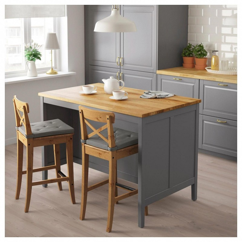 eco friendly kitchen design with wood top kitchen island bar stools with tufted upholstery mute blue kitchen cabinets white subway tile backsplash