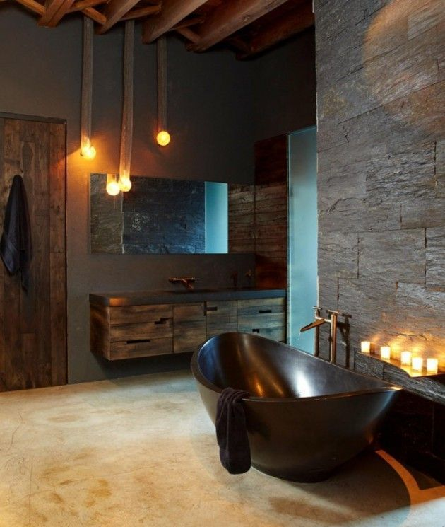 industrial bathroom design with glossy black bathtub floating wood bathroom vanity frameless wall mirror textured walls