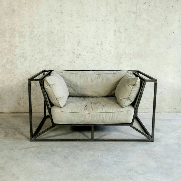 modern industrial chair with black metal frame and gray cushions