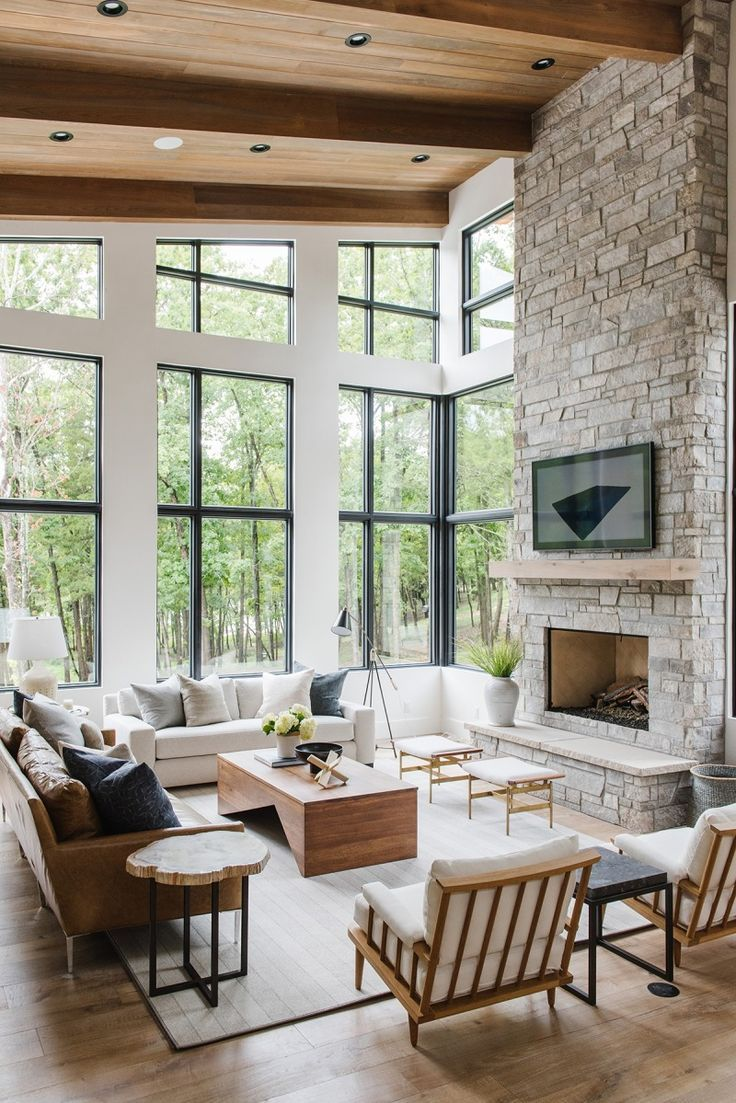 modern rustic living room with minimalist fireplace stone brick walls industrial style glass windows with black frame and trims white modern sofa wooden coffee table in modern style