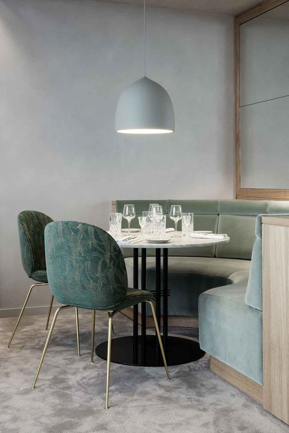 soft and warm blue pendant in oversize half round couch in light blue blue dining chairs with slim metal legs