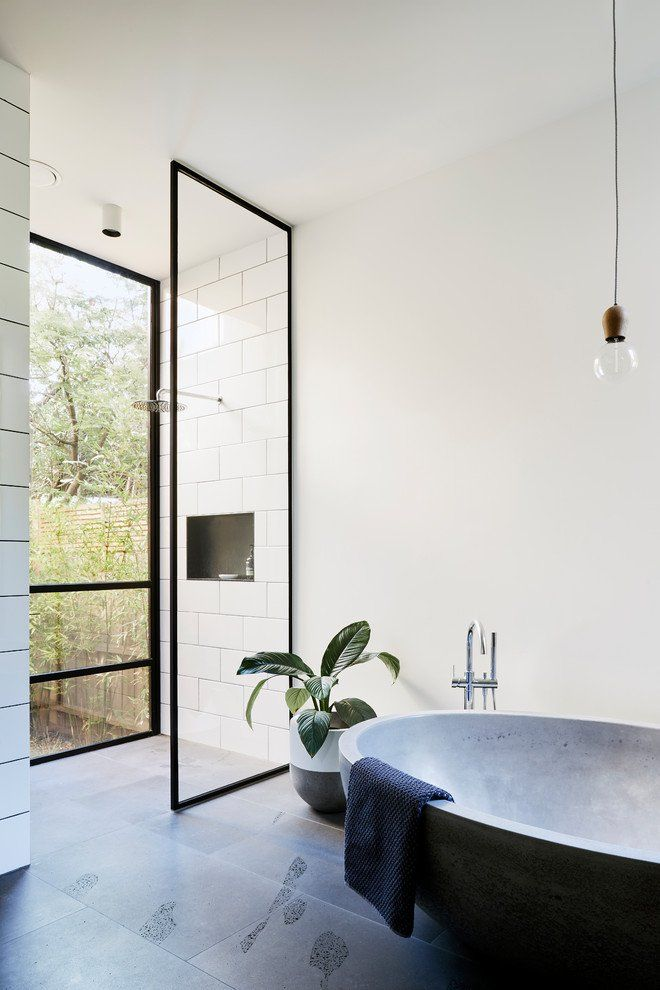 stunning industrial bathroom idea with minimalist black bathtub walk in shower with glass door with black frames potted greenery